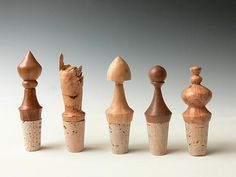 """""""5 Wood BottleStoppers"""" Created by Dewey Garrett One of a Kind Wooden bottle stoppers in various woods turned on a wood lathe. These are made from scraps of wood left over from turning bowls -- the wood is to pretty to throw away! Sold in a set, as shown."""