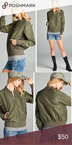 •army green bomber jacket• army green bomber jacket features zip up front and zipper pocket on left arm.  Elastic waistband.  Side pockets with buttons.  Material is 100% polyester.  Small bust measures 38 inches, waist 32 inches, length 24 inches. Medium bust measures 42 inches, waist 34 inches, length 25 inches.  Large bust 45 inches, wait 50 inches and length 25 inches. Jackets & Coats Utility Jackets