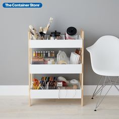 Utility storage gets a fresh makeover with this beautiful, functional shelving unit. Its low profile fits easily in kitchen pantries, kids' rooms, home offices - wherever clutter accumulates. Three tiers keep contents organized inside bin-like shelves. Top and middle shelves feature divided sections for small supplies or toys while the bottom shelf is open to accommodate larger items.