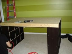 Like this homemade craft table out of closetmaid shelves because you can leave the backing off and get to the objects from both sides.