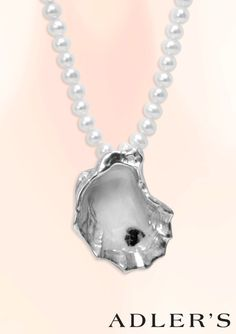 "Adlers Exclusive Sterling Silver Oyster Pendant is hand-painted making each design a one-of-a-kind. Wear with our 17"" freshwater pearl necklace for true Southern Louisiana charm!"