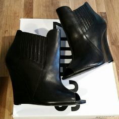 Schutz Deka Wedge Ankle Peep Toe Booties Worn twice, comes with dustbag and original box, bottoms are scuffed because they were very slippery to walk in at first. That is the only sign of wear, other than that they are in perfect condition. SCHUTZ Shoes Ankle Boots & Booties