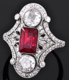 Art Deco Ruby and Diamond Ring; would prefer a round/oval center stone, but good design inspiration