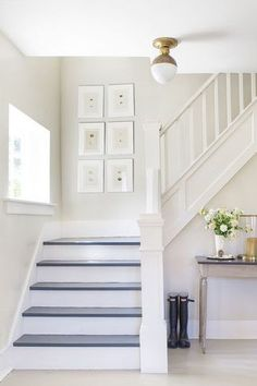 In this white-washed Hampton's home, gray blue stairs set off gray white walls. stairs How Painted Stairs Can Completely Transform Your Home Painted Staircases, Painted Stairs, Spiral Staircases, Staircase Remodel, Staircase Makeover, White Staircase, Staircase Design, Farmhouse Stairs, Cottage Stairs