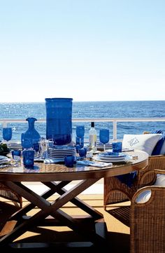 Blue glass and wicker furniture are perfect for a coastal outdoor living area Coastal Homes, Coastal Living, Coastal Style, Coastal Decor, Outdoor Dining, Indoor Outdoor, Outdoor Spaces, Estilo Tropical, Ralph Lauren