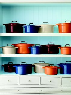 Martha Stewart Enamel Cast Iron.   I have the 8 and 5 qt ones with the classic knob.  Love them so much!