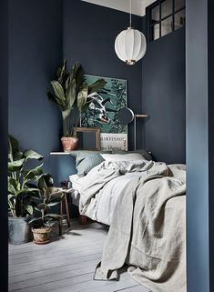 small but calming blue and gray bedroom | scandinavian bedroom decor with plenty of plants | blue grey wallpaint and neutral and tonal bedding in a winning combination | Make the look your own with a Bemz bedspread in Natural linen from Designers Guild
