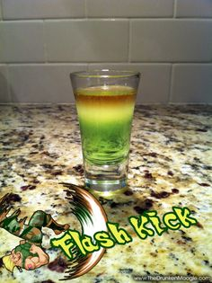 Ingredients:  1 oz Dekuyper Sour Apple Pucker  .25 oz lemon juice  .25 gold rum    Directions: Pour the Sour Apple Pucker first in a shot glass. Layer the lemon juice in the middle and the gold rum on top. Down, up, kick and serve. Drink while listening to Guile's theme.