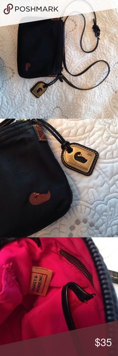 Dooney & Bourke Crossbody Bag Black Crossbody in great condition. The inside is hot pink and has a tiny little stains from general usage over the years, but the outside of  the bag is in great shape. No rips or tears. Dooney & Bourke Bags Crossbody Bags