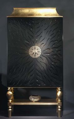 COCKTAIL CABINET DESIGN 5878 BLACK GOLD LEAF - A RARE UNIQUE DESIGNER COCKTAIL CABINET FINISHED IN BLACK 'CRAQUELE' WITH GOLD OR SILVER LEAF CROWN & STAND