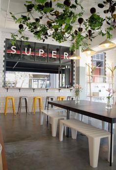 Superette | Cape Town Who needs a chandelier when you can have those hanging plants?! Stunning.
