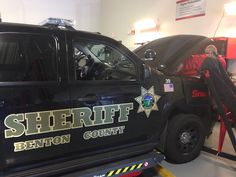Students in the process of adding propane fuel functionality to a new Benton County Sheriff Chevy Tahoe.