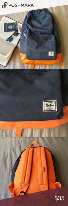 "Herschel Supply Co. Settlement Backpack (EUC!) Adventure is out there! Find it with Herschel's Settlement backpack in Navy/Mandarin Orange. Unisex. Used only once! In almost-new condition. Interior sleeve pocket can hold up to a 15"" laptop. Additional front compartment with a key clip. Padded and adjustable straps for a custom fit. Exterior: 100% polyester. Lining: 100% nylon. Bottom Width: 12 1⁄2 in Middle Width: 12 in Top Width: 10 1⁄2 in Depth: 5 in Height: 18 in Strap Length: 33 1⁄2 in…"