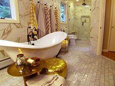 Turkish inspired bathroom done by Genevieve Gorder/ hooks, marble, DARK bath fixtures, metallic pouf = love.