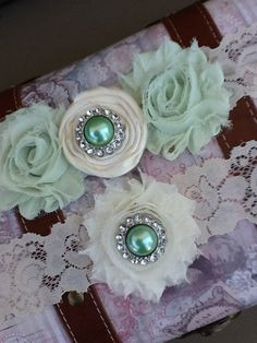 mint green/ ivory garter  / bridal  garter / lace garter / toss garter / wedding garter / vintage inspired lace garter. $30.99, via Etsy.