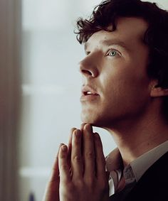 Sherlock thinking.  Also, this shot shows off his strikingly beautiful eyes.