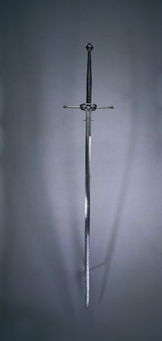 Two-Handed Sword | Cleveland Museum of Art Spain, Toledo (?), second half of 16th Century steel, wood and leather grip, Overall - l:167.30 cm (l:65 13/16 inches) Wt: 2.24 kg Blade - l:126.00 cm (l:49 9/16 inches) Quillions - w:31.80 cm (w:12 1/2 inches) Grip - l:40.00 cm (l:15 11/16 inches) Ricasso - w:17.20 cm (w:6 3/4 inches). Gift of Mr. and Mrs. John L. Severance 1916.1507