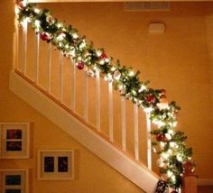 Use wide lighted garland with ornaments for staircase.