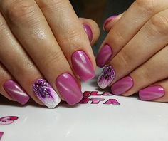 Glittered Pink Flowers. For all those girly girls out there, this one is something worth trying. You can equip your nails with this amazing nail art design that features the dazzling play of glitter, studs and different nail paints.