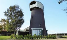 Beech Architects converted a 125-year-old windmill in Suffolk, England, into a modern guest house.