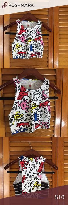 Keith Haring Crop Top Keith Haring Crop Top / art Top / size small / forever 21 / racerback Style with black striped open sides / colorful and cute! Great with overalls, shorts or as a sports bra! Forever 21 Tops Crop Tops