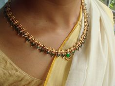 This post is about a necklace which is as old as my mom. The design is very commonly seen in Kerala and is almost always teemed up with . Gold Bangles Design, Gold Jewellery Design, Bead Jewellery, Beaded Jewelry, Saree Jewellery, Latest Jewellery, Gold Temple Jewellery, Gold Jewelry, Gold Necklace