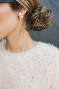 low messy bun, pearl earrings, fluffy sweater