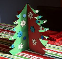 My kids made the centerpiece for our table this year - a cardboard Christmas tree made from packing boxes.