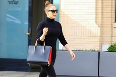 Since 2011, Jennifer Lopez's namesake Kohl's line has made it easy and affordable for women of all sizes to channel their inner J.Lo. And while each collection brings an array of styles, with everything from off-the-shoulder blouses to curve-hugging jeans and fab shoes, it was her new handbag designs that instantly caught our attention.