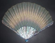ART NOUVEAU CARVED MOTHER OF PEARL STICKS, EMBROIDERED PAILLETTES LEAF, GEORGES BASTARD. RETAILED BY MAISON DUVELLEROY. FRANCE, c.1900.  27 cm long, 34 cm wide.