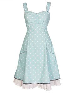Norah - Aqua http://www.ecouture.com/norah-aqua.html… DRESS IN ORGANIC COTTON  The dress is inspired by 50s pinup and Mad Men style, this knee-length dress is made from 100% organic cotton [GOTS-certified] with polka-dots. The elasticated panel at the back and side zipper provide flexibility. The dress has pockets and it is lined with a very comfortable bamboo-silk. A beautiful dress for wedding and communion. It is named after the great singer Norah Jones.