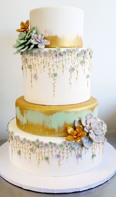Gold Brushed wedding cake with gumpaste succulents and delicate vines.