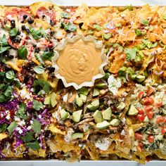 Our epic nachos combine everyone's favorite Super Bowl flavors all in one show-stopping dish. Make all five kinds of nachos or just choose your favorites; either way, you've got a winner. Aperitivos Super Bowl, Buffalo Chicken Nachos, Tapas, Meat Lovers Pizza, Colby Cheese, Cubed Potatoes, Canadian Bacon, Shredded Pork, Peeling Potatoes