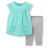 With little pockets and a comfortable fit, this geo print top looks great over solid stretchy capris.<br>