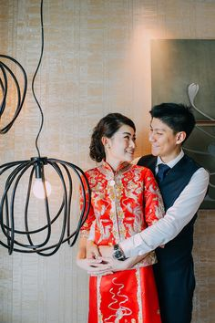 Bride and groom in traditional Chinese wedding outfits // Wedding on the Lawn at W Singapore: Han Wei + Sylvia