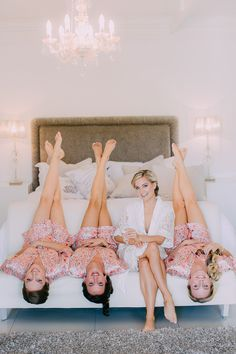 Stunning bridal portrait ideas with bridesmaids in floral robes. Bride getting ready photos you must have.