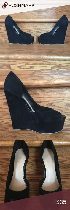 Suede Peep-Toe High Wedges by Carvela Carvela by Kurt Geiger: Beautiful black suede peep-toe wedges with patent accent on the toes.  Super high yet comfortable. These shoes definitely make a statement and will get you noticed. Carvela by Kurt Geiger Shoes Wedges