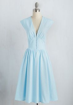 In preparation for the perfect picnic, you don this sky blue dress by Bettie Paige and take a twirl in the mirror! A gingham print, V-neck, and loop-fastened buttons along a defined waist panel give this midi the retro silhouette you so adore, making for a look that's even sweeter than the cherry pie you tote to the party.