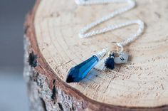 GIFT FOR HER   Blue Sapphire Point Necklace with Cute Tassel and Initial #swarovski #necklace #jewelry #gifts #atlantisnecklace #sapphirenecklace #bluenecklace #etsyseller #etsyfinds #etsyshop  #etsygifts #devikabox  #giftforher #giftideas