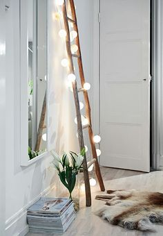 I love this white wood floor, fairy lights and the sheepskin