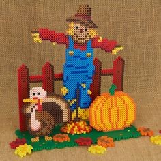 Build this dimensional scene of a scarecrow in the pumpkin patch with Perler beads! Easy tab/slot assembly. From designer Kyle McCoy.