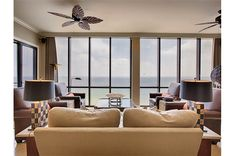 Stylishly furnished living area with floor-to=ceiling windows and Gulf view at Emerald Towers Entry Gates, Dream Vacations, Ideal Home, Ceiling Lights, Living Room, Condos, Towers, House, Furniture