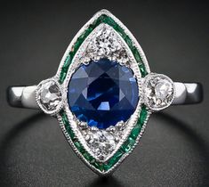This Art Deco navette-shaped emerald, sapphire, and diamond ring was listed for sale at Lang Antiques. See more rings here: http://diamondsinthelibrary.com/ring-roundup-emeralds-with-friends/