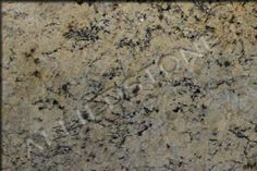 Description: Opal Gold is 3cm exotic granite with a beautiful balance of gold and gray tones in a creamy background. This color combination works well in both traditional and modern spaces looking for a fairly neutral stone that delivers great character. The speckled patterning of Opal Gold has striking pattern movement that is accentuated by the dark spots.