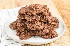 These classic chocolate peanut butter no-bake cookies are soft, chewy, and filled with rich chocolate peanut butter flavor. Plus, they are super easy to make in 15 minutes with just a few simple pantry ingredients such as oats, peanut butter, and cocoa. Also referred to as chocolate oaties, preacher cookies, cow patties, and fudge cookies, these old-fashioned chocolate peanut butter no bakes are a true classic. Just like the recipe that grandma made when you were little.