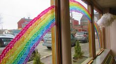 We painted this knitted rainbow across our windows in April of 2015.
