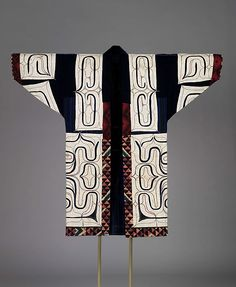 Robe with appliquéd traditional design  Ainu  Cotton, appliquéd, embroidered, and printed  Centimetres: 127.5 (length), 140 (width)  19th century. ROM Images