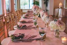 Wedding Reception Long Feasting Table Decor with Pink and Ivory Floral Bouquet Table Centerpieces with Roses and Hydragenas, Pink Table Linens, and Candlelight | St. Petersburg Wedding Planner Special Moments | Chair Rentals Signature Event Rentals