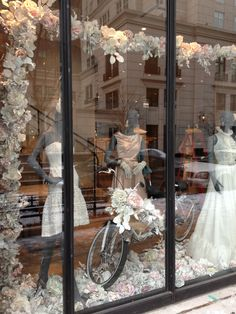 Houston store's spring windows. Stunning I would love to install this for a wedding store. LM