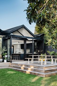 The distinct roofline of Pleated House not only pays homage to midcentury architecture, but also makes room for clerestory windows that flood the interiors with light. Style Villa, Living Style, Weatherboard House, Melbourne House, Australian Homes, Outdoor Living, Outdoor Decor, House Extensions, Outdoor Entertaining